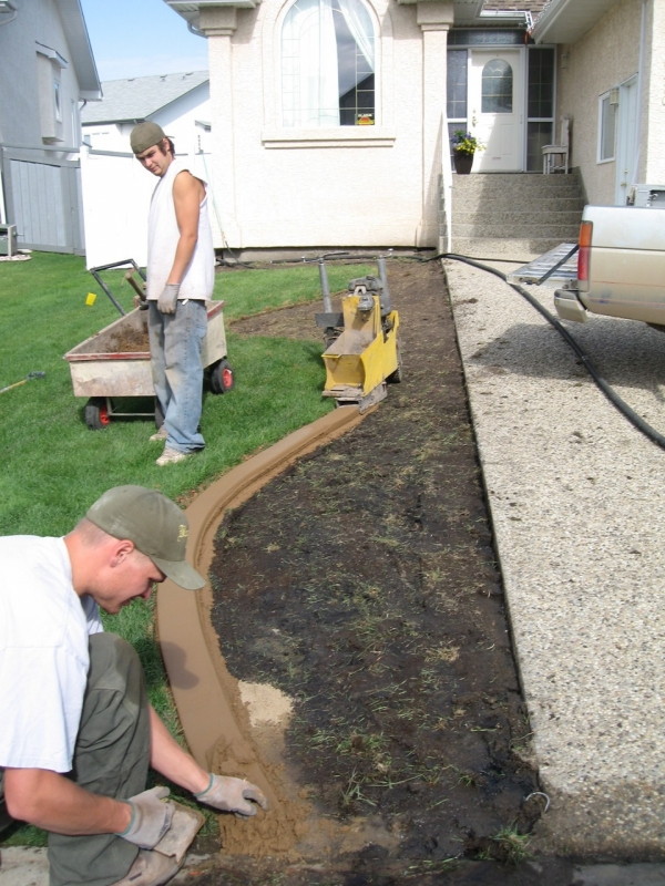 Karl and Brian at work trowelling the curb