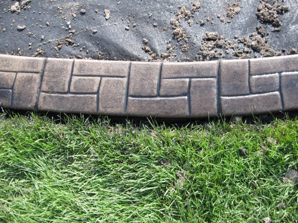 Base-   light sand Release-  black Stamp- castlerock curb