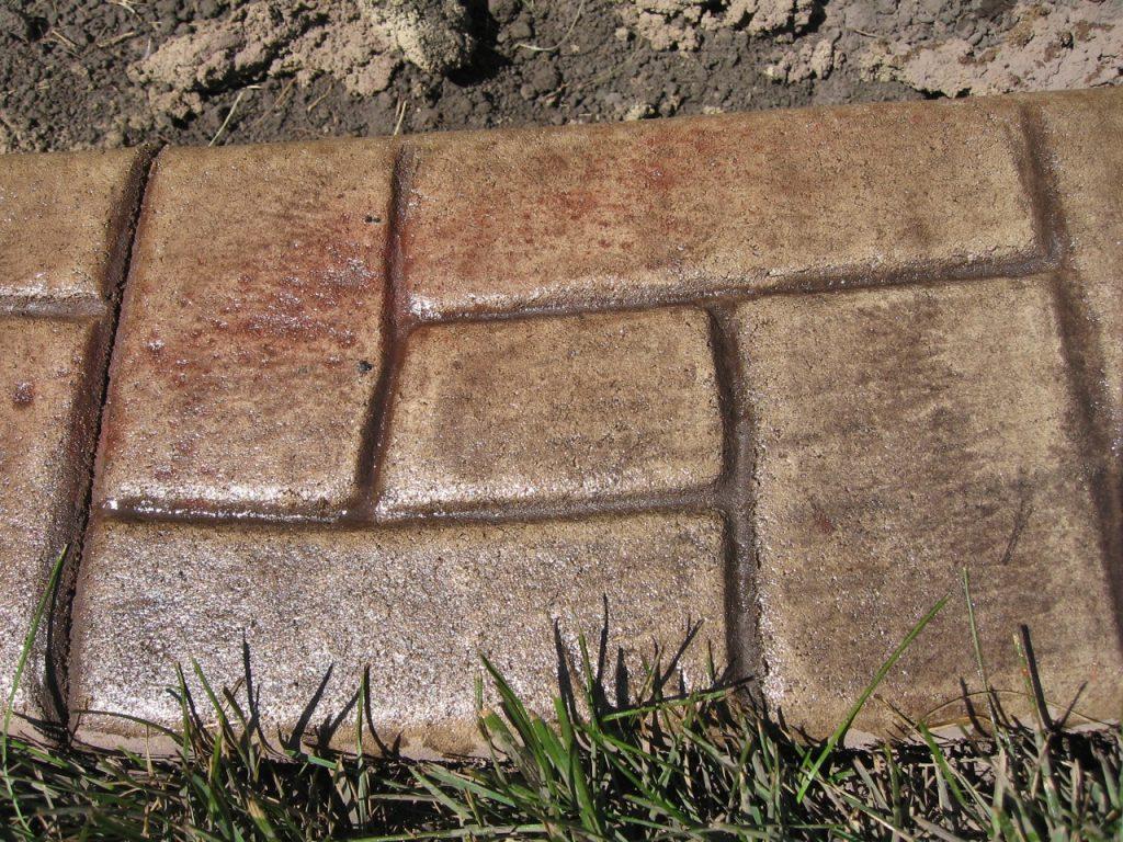 Base- sand  Release- walnut, red hi lights  Stamp- castlerock curb
