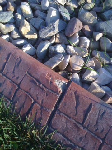 a competitor's kwik kerb using the slurry coat they brag about- shows white when chipped- not repairable. Slurry makes bright colours, but doesnt last well.