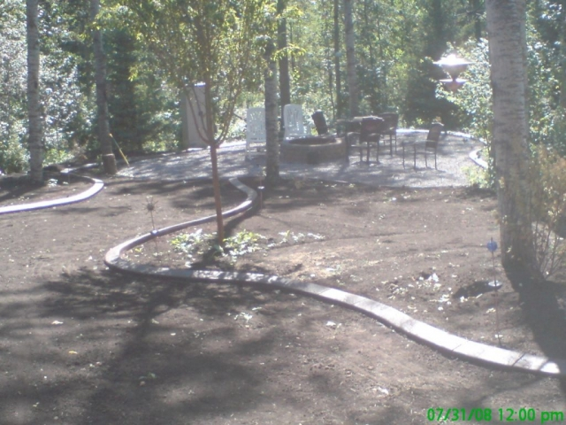 This will make a wide path of lawn down to the fire pit area