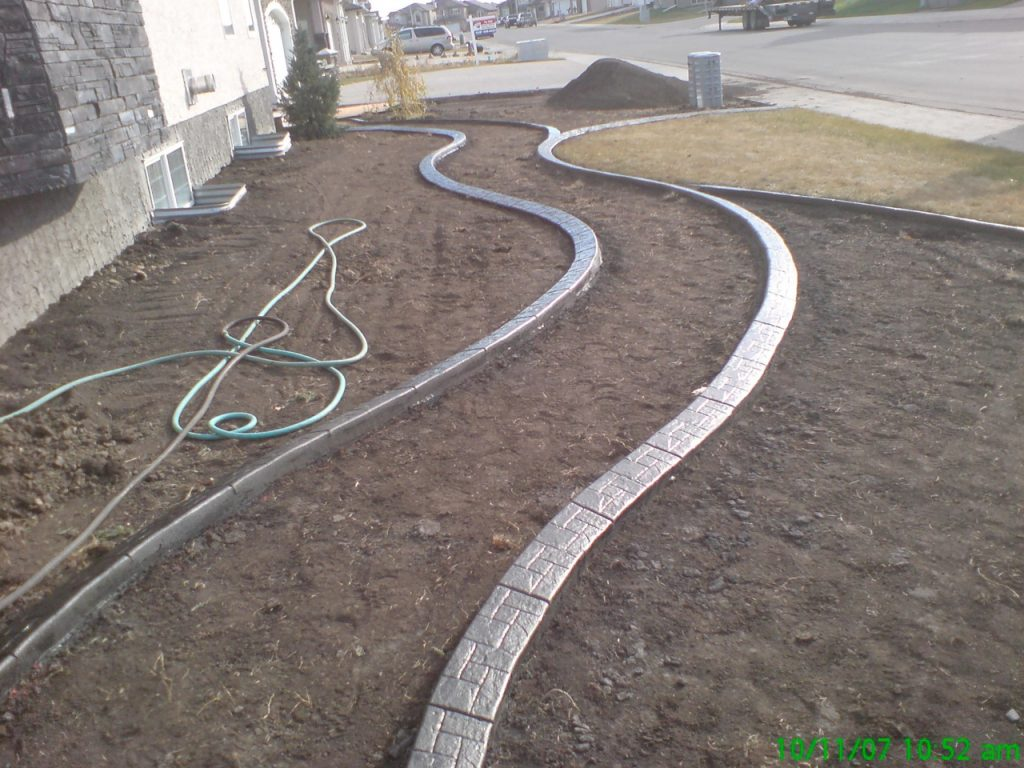 nice curvy path from front to back yard without high cost of pouring a sidewalk  I think they plan to use gravel and flagstones