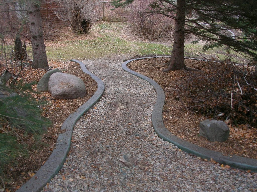 gravel path bordered by curbing