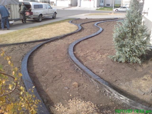 curb breaks up a big blank side yard