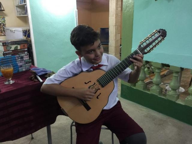 cuban boy playing the Laud