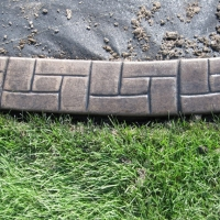 Base-   light sand Release-  black Stamp- castlerock curb