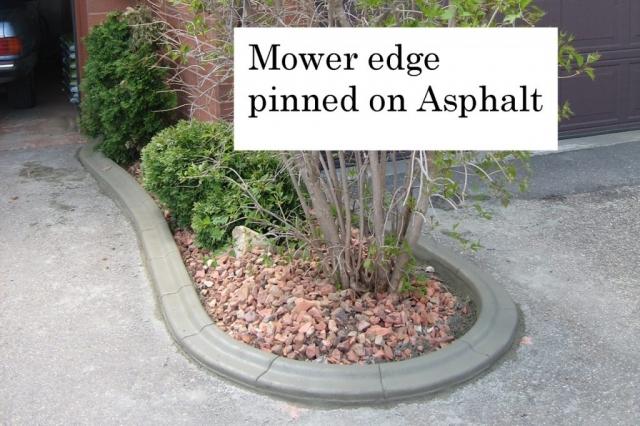 Pinned on asphalt curb keeps bed defined