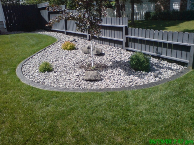 curb saves fence from mowing damage
